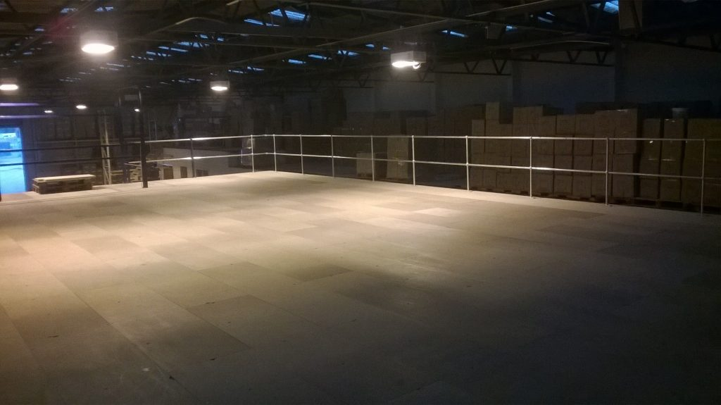 Used mezzanine floor with wide roll over pallet gate and new handrail