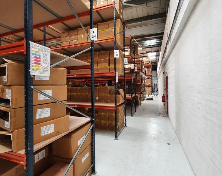 Longspan shelving used for storing and picking various clothing and accessories. Warehouse shelving.