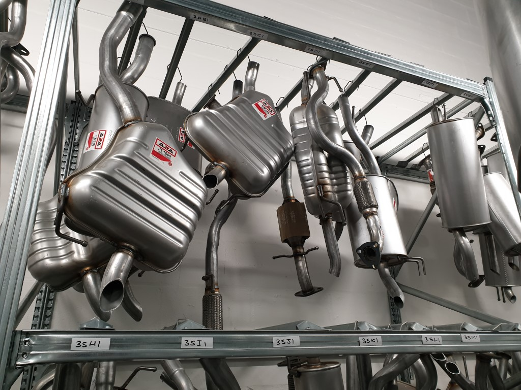 Unirack shelving storing hanging auto parts of various shapes and sizes