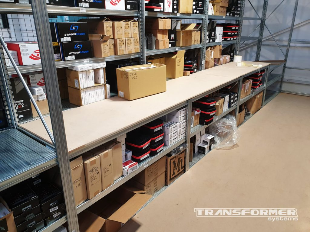 Two-tier Shelving with Custom Packing Benches Built into Shelving System.