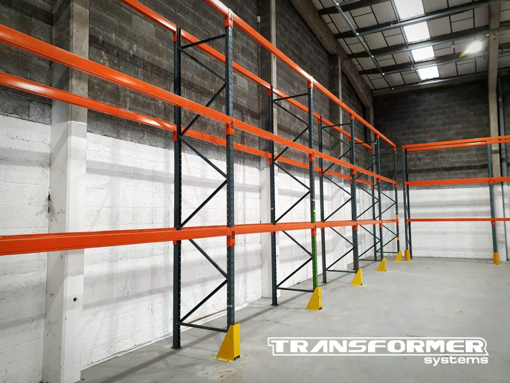 Used pallet racking and column guards for racking protection. The pallet racking is Dexion Speedlock style, with orange 2700mm beams and 4m high frames.