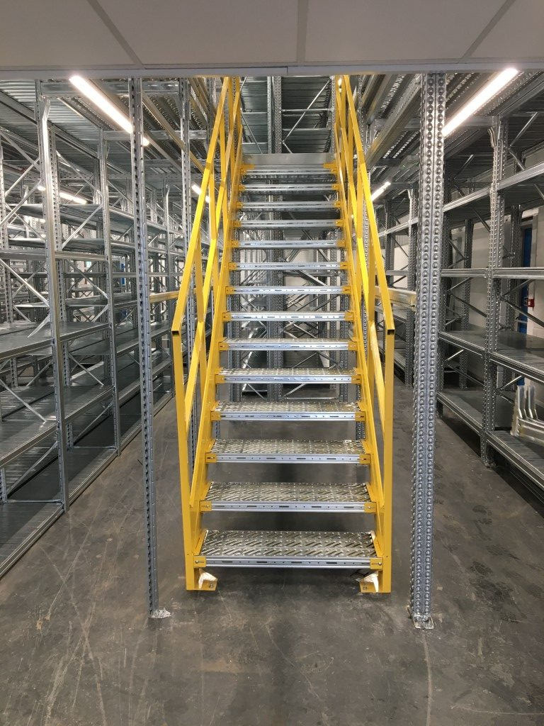 Staircase for two-tier industrial metalsistem shelving. Powder coated yellow.