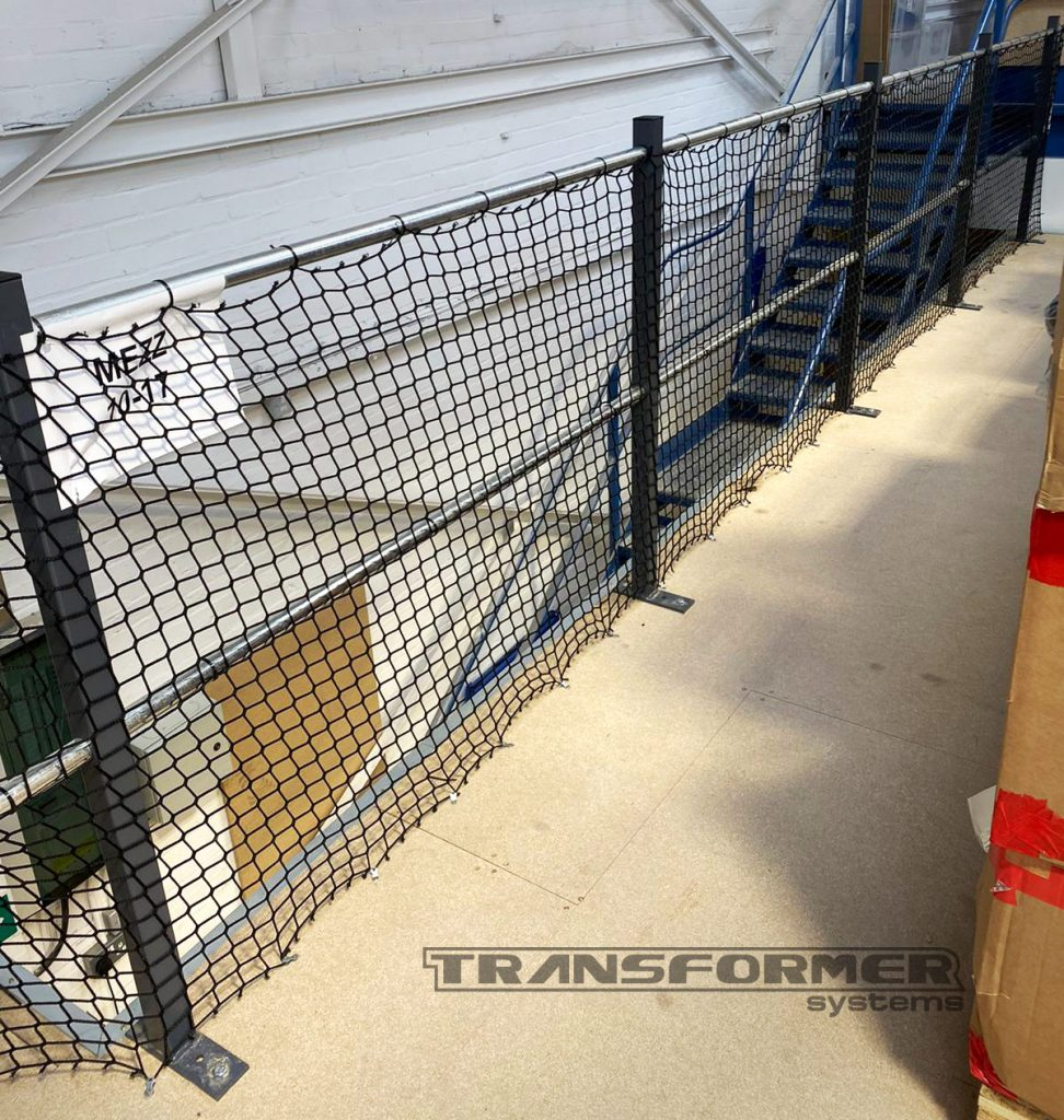 Handrail mesh netting protection to protect personnel below mezzanine floors.